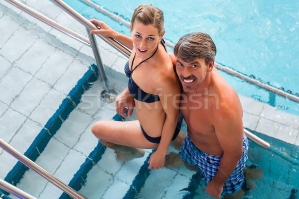 Couple on steps of pool in thermal spa  Stock photo © Kzenon