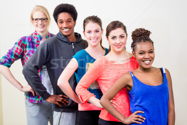 Group of young people having dance lessons Stock photo © Kzenon