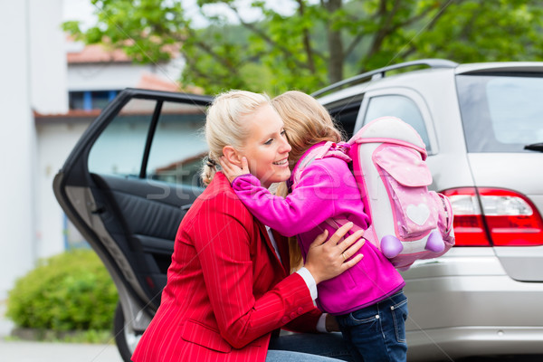 Mother consoling daughter on first day at school Stock photo © Kzenon