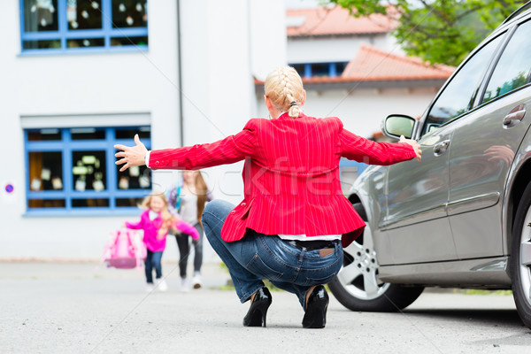 Mother hugging child after bringing her to school Stock photo © Kzenon