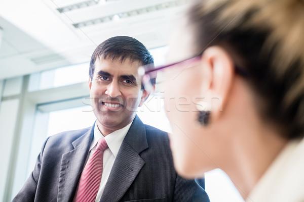 CEO smiling at his secretary in office Stock photo © Kzenon