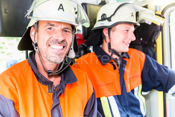 Stock photo: Fire fighters on their way to fire ground