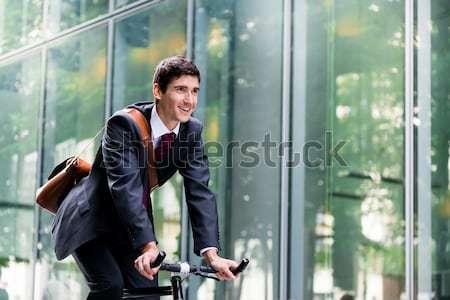 Aktywny młody człowiek uśmiechnięty jazda konna użyteczność rower Zdjęcia stock © Kzenon