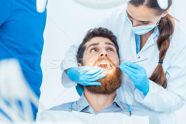 Güvenilir dişçi steril temizlik yandan görünüş kadın Stok fotoğraf © Kzenon