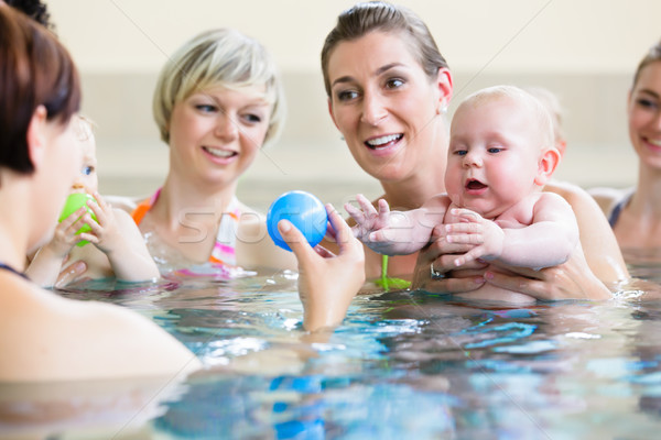 Babies and their moms at mother-and-child-swimming class Stock photo © Kzenon