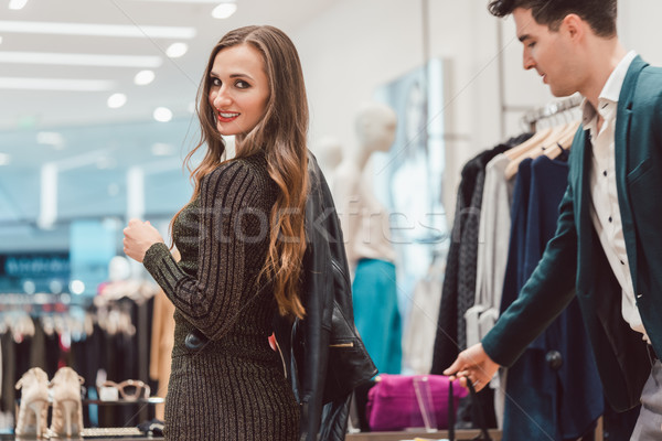 Woman trying a new leather jacket in hip fashion boutique Stock photo © Kzenon