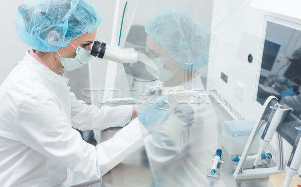 Scientist in lab conducting biotechnological experiment  Stock photo © Kzenon