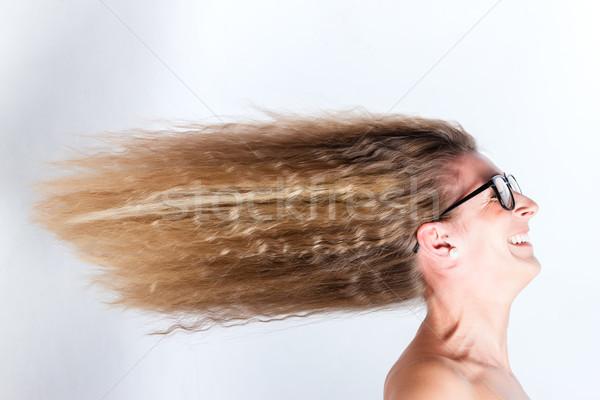 Long hair of woman blown by the wind Stock photo © Kzenon