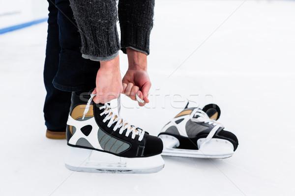 Hand's tying skating shoes lace Stock photo © Kzenon