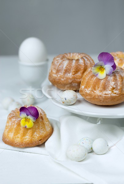 Stock photo: Easter cakes, pansies and eggs