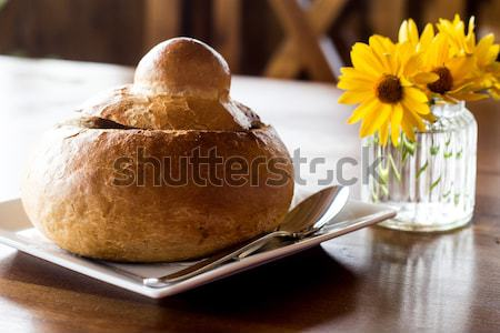 Sour rye soup - traditional polish soup in bread called zurek or white barszcz Stock photo © laciatek