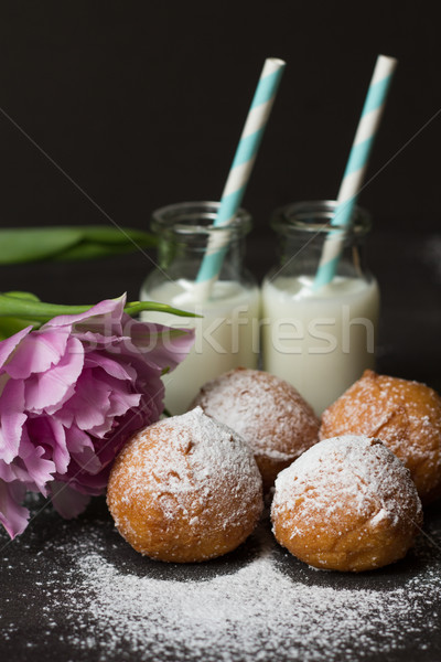 Jelly doughnuts, pink tulip and two bottles of milk Stock photo © laciatek