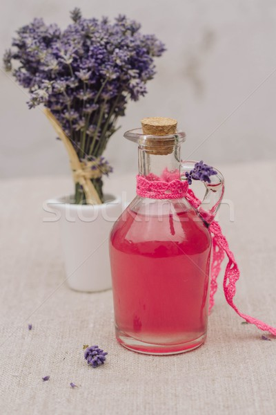 vintage glass bottle with natural lavender syrup and a bouquet of lavender Stock photo © laciatek
