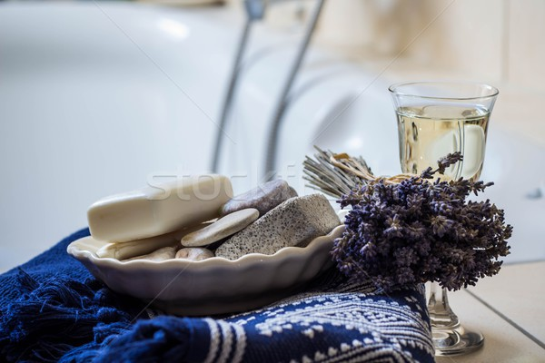 lavender flowers, towel, bathroom accessories and a glass of white wine - home spa Stock photo © laciatek