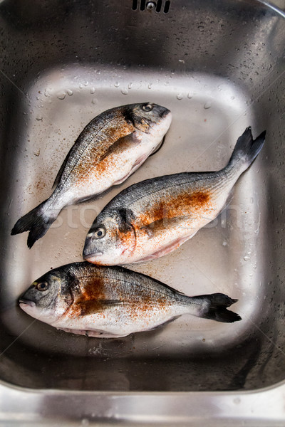 Framed and seasoned fresh dorada fish Stock photo © laciatek