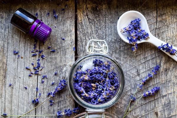 dried lavender flowers and lavender oil on wooden vintage background - herbal background Stock photo © laciatek