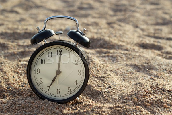 Alarm clock on the beach  Stock photo © laciatek