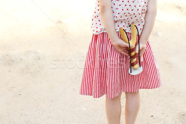 Girl holding a slingshot in her hands Stock photo © laciatek