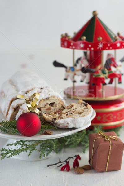 Christmas cake - Stollen, bauble and carousel music box Stock photo © laciatek
