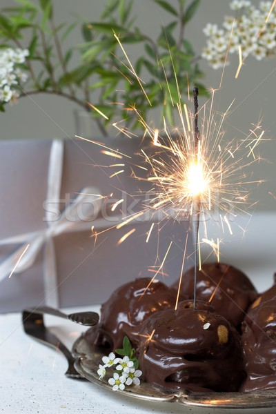 gift, cream puffs and sparklers Stock photo © laciatek