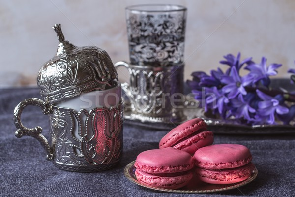pink French macarons and Turkish coffee in a traditional cup Stock photo © laciatek