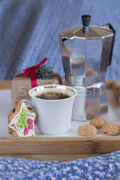 Coffee, christmas gift and almond cookies on a wooden tray Stock photo © laciatek