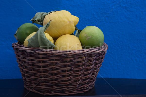 Taze limon sepet mavi ahşap Stok fotoğraf © laciatek