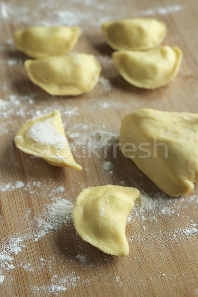 preparing dumplings- raw dumplings - polish pierogi Stock photo © laciatek