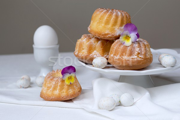 Easter cakes, pansies and eggs Stock photo © laciatek