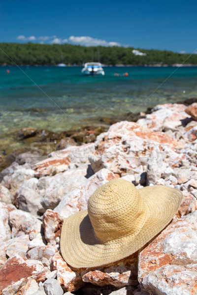Straw hat on the stony beach of the Adriatic Sea - holiday on Croatia Stock photo © laciatek