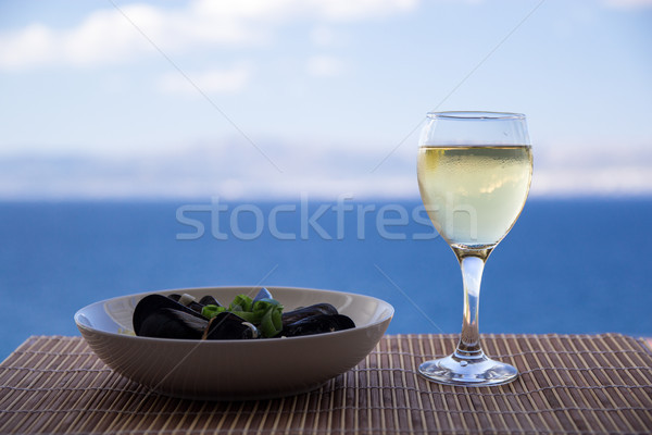 Tasty moule and a glass of white wine Stock photo © laciatek