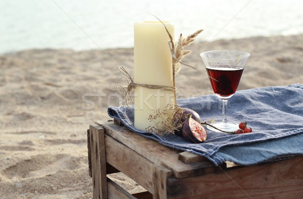candles and red wine - romantic dinner on the water in Scandinavian style  Stock photo © laciatek