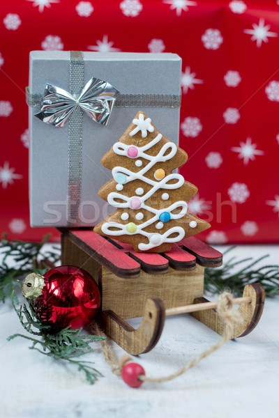 Gingerbread Christmas tree and gift on wooden sledge Stock photo © laciatek