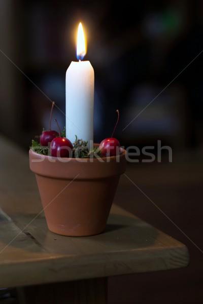 Advent candle lit. Stock photo © laciatek