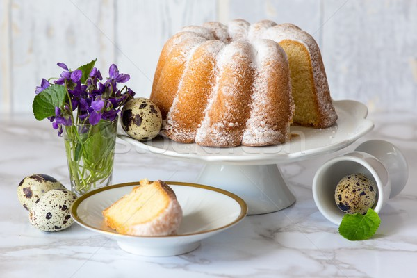 Easter tasty sour cream pound cake, quail eggs and violets Stock photo © laciatek