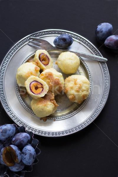 Potato Dumplings With Plums Stock photo © laciatek