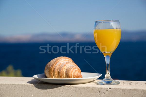 Kruvasan cam portakal suyu deniz gıda arka plan Stok fotoğraf © laciatek