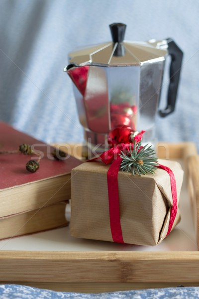 Christmas coffee, gift and old books in bed Stock photo © laciatek