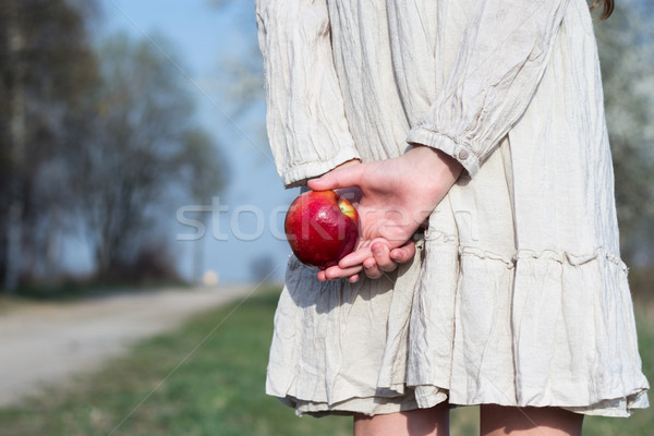 girl with a red apple in hand on the road Stock photo © laciatek