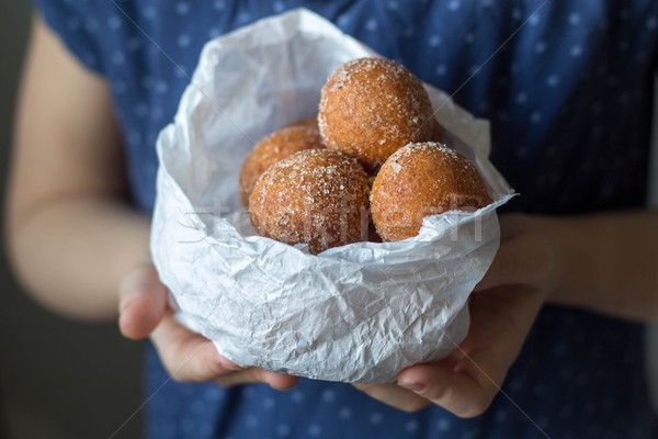 mini donuts in a paper bag in the hands of a girl Stock photo © laciatek