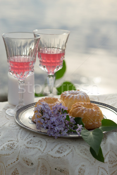 Two glas of pink wine and lilac on the table outdoors Stock photo © laciatek