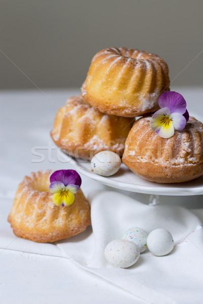 Easter cakes, pansies and eggs Stock photo © laciatek