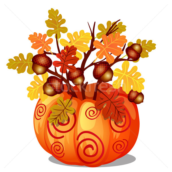 Handmade autumn decor of sprigs of oak with yellowed leaves and acorns in natural vase of ripe pumpk Stock photo © Lady-Luck