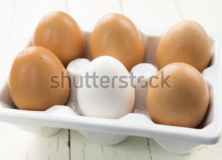 One White Egg Amongst Brown Eggs Stock photo © LAMeeks