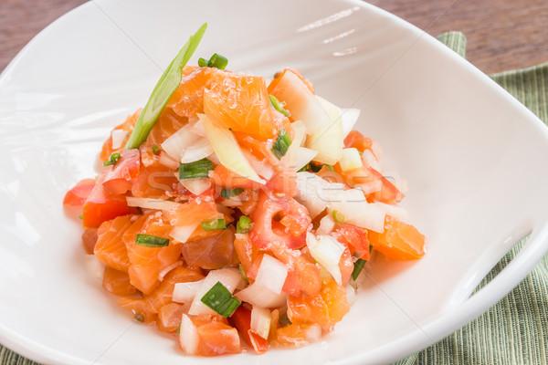 Salmão tradicional acompanhamento tomates cebola comida Foto stock © LAMeeks