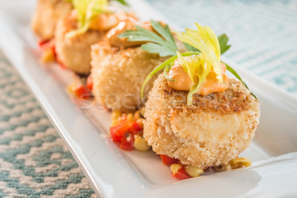 Crab cakes with corn relish Stock photo © LAMeeks