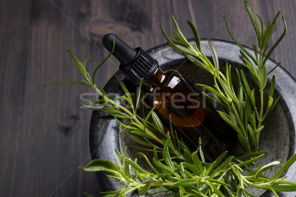 Rozmaring illóolaj aromaterápia sötét fából készült étel Stock fotó © Lana_M