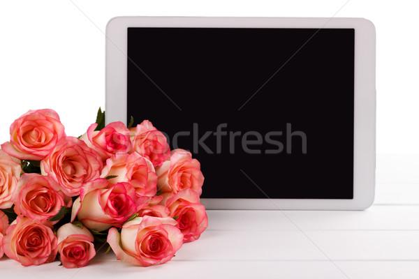 таблетка розовый роз букет белый пространстве Сток-фото © Lana_M