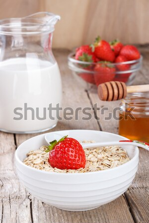 Healthy cereal with milk, honey and strawberry  Stock photo © Lana_M