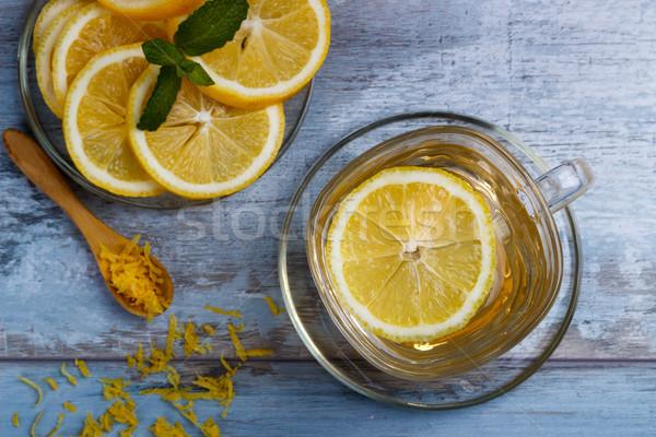 Foto d'archivio: Cup · limone · tè · vetro · blu · rustico